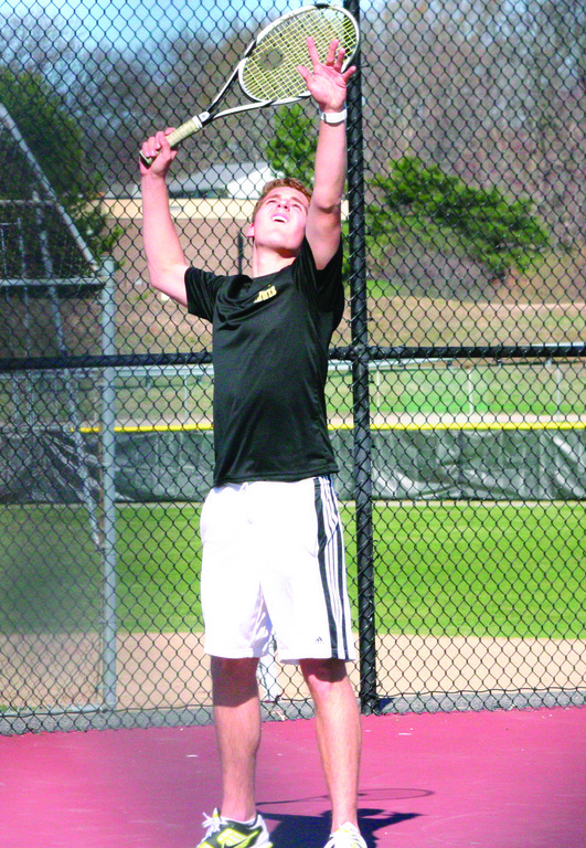 STEPPING UP: Sam Adamo takes a serve at No. 4 singles last week against Cranston West.