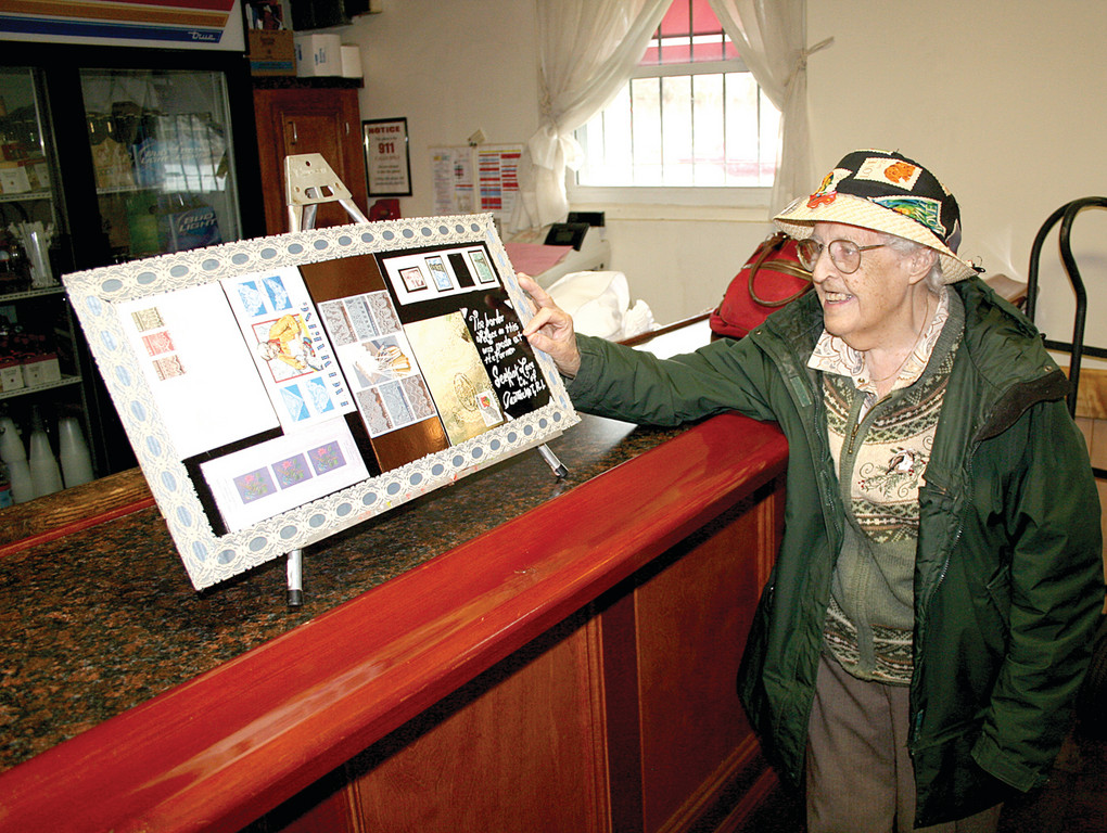 SEEKONK LACE FACTORY: Viola Gianetti of Seekonk shows off her display, which highlights the Seekonk Lace Factory where she worked for almost 50 years. The display is decorated with a border made out of actual lace from the factory itself.