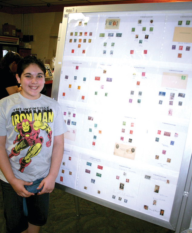 COLLECTING IS FOR KIDS TOO: Caroline Cowart stands by the presentation board put together by her Cadette Girl Scout Troop 276. Troop 276 has been working with President Chester Browning for three years. This is the first year the troop has had a board on display in the show.