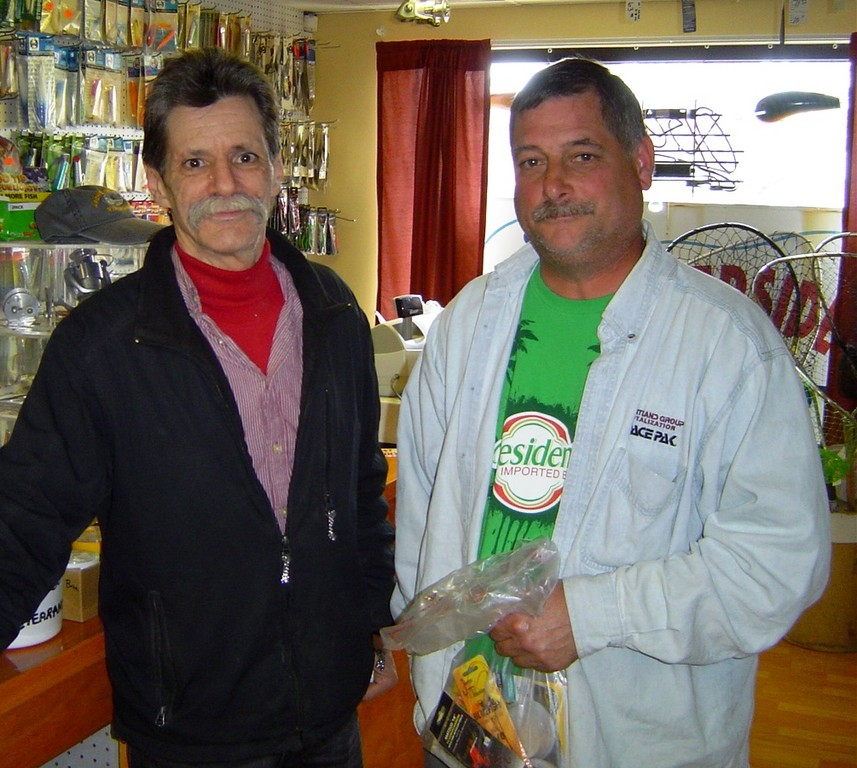 John Littlefield (left) of Archie's Bait & Tackle with customer Wayne Eccleston of East Providence as he buys tackle on Opening Day 2011.