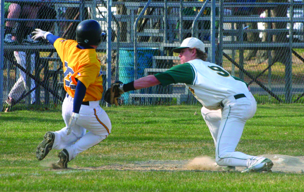 TAGGED: Reed Gamache puts the tag on Barrington's Collin Fay as part of a 5-2-5 putout in Tuesday's game. The Hawks trailed 1-0 after one, but Bobby Indeglia didn't allow anything else and the Hawks broke out for seven runs in the 7-1 victory.