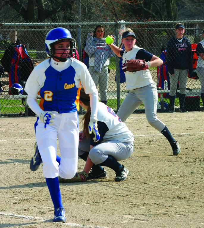 FAST PACE: Vets' Amanda Graves sprints down the first base line as Toll Gate pitcher Katie McCaughey fields a bunt and lines up a throw in Monday's game.