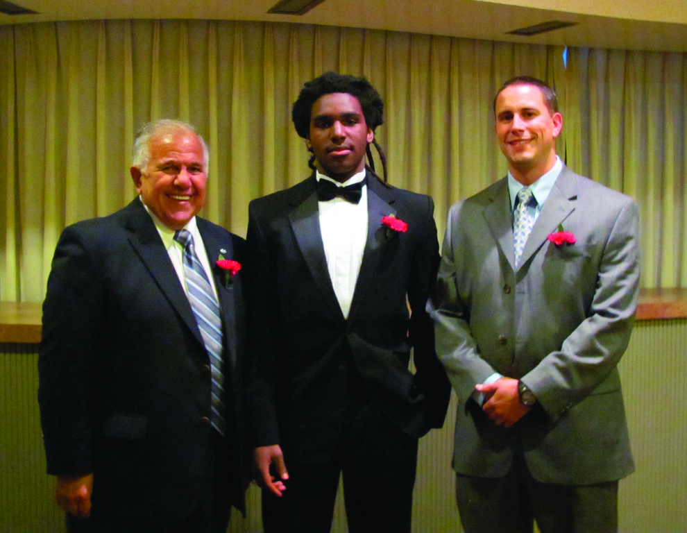 HONORED: Above, former Toll Gate head coach and athletic director Emo DiNitto (left), 2011 running back Derick Durand and former Titan standout Eric Anderson, who is now the head coach at South Kingstown High, were among the winners of prestigious honors during the Providence Gridiron Club's annual Awards Night last week.