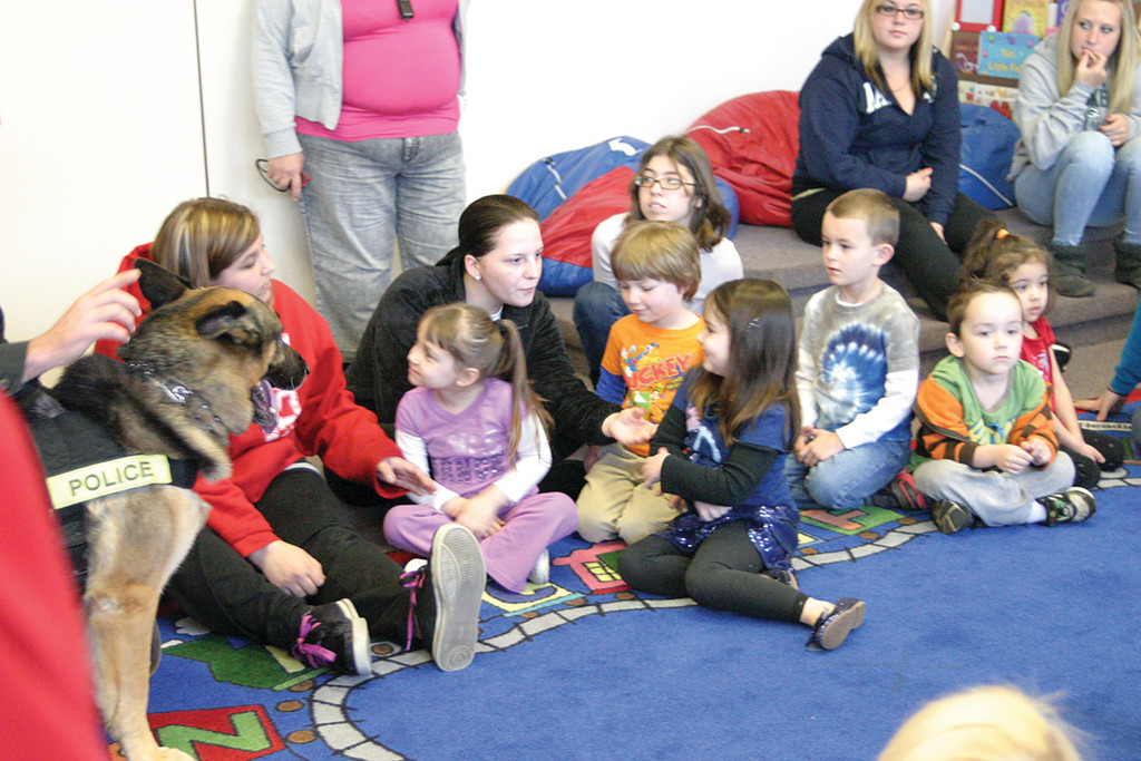 THEY LOVE BEAR: The room was full of giggles and laughter as Bear got to play with the kids as Trooper Carlsten taught them how to stay safe. The preschoolers of room 208 at the Pilgrim Child Development classroom all got a chance to pet Bear and then later they played hide and seek as Bear was commanded by Carlsten to find everyone.