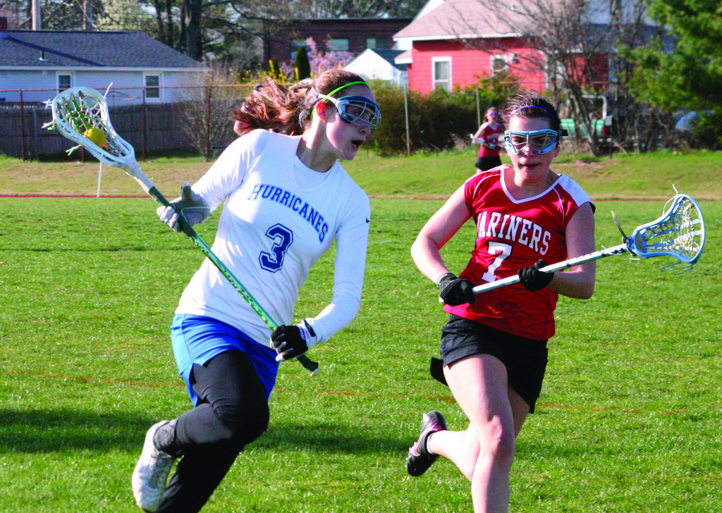 SPRINT: Vets' Lauren Almonte runs past Narragansett's Hannah Ragozzino in Friday's game.