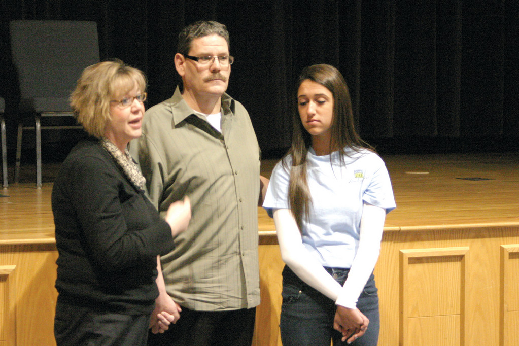 A FAMILY UNITED: Mary Anne Giansanti, left, tells the story of her brother, Jim Quinn's liver failure and organ transplant. At right is Giansanti's daughter, Alissa, who organized the presentation on organ donation as part of her senior project at Toll Gate.