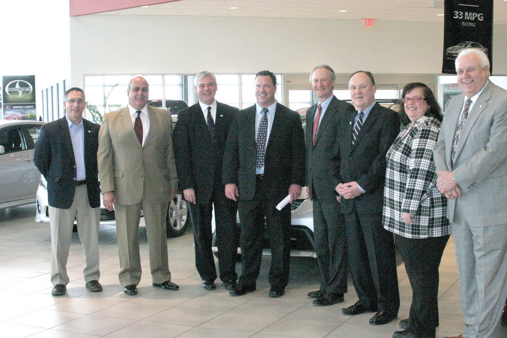 SUPPORTIVE OFFICIALS: Joined by seven elected officials, including Governor Lincoln Chafee, Mayor Scott Avedisian and more than half of the Warwick City Council, co-owner and vice president of Balise Motor Sales Co. Mike Balise (center) held a press conference at his Toyota showroom at 1400 Post Road to announce the $8 million expansion of his company. The expansion will create 200 temporary construction jobs, as well as 45 new, permanent jobs.