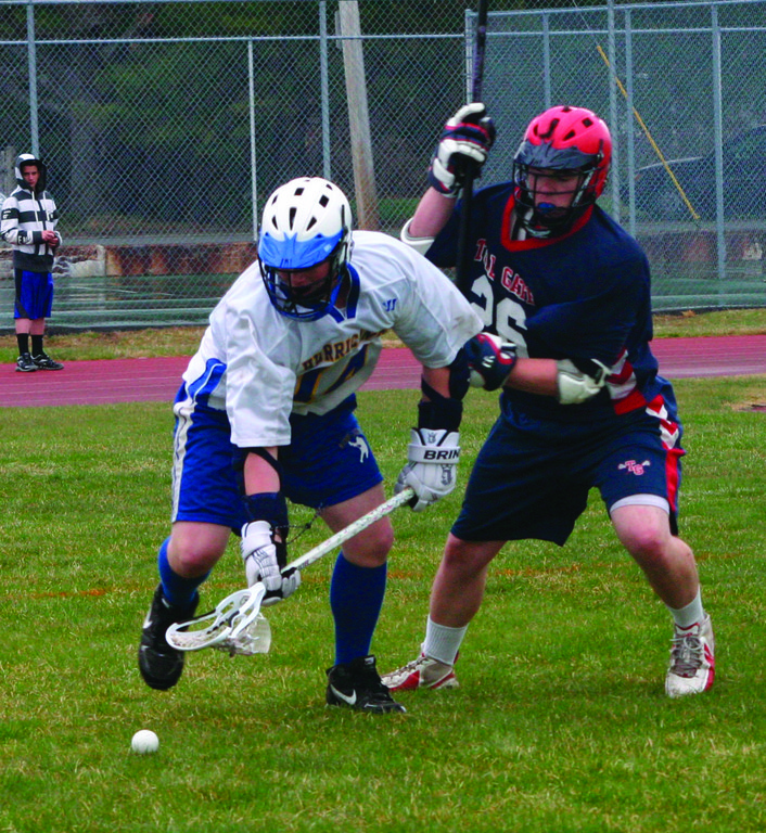 ONE ON ONE: Vets' Nathan Brotman battles for a ground ball with Toll Gate's Colby Connell in last week's game.
