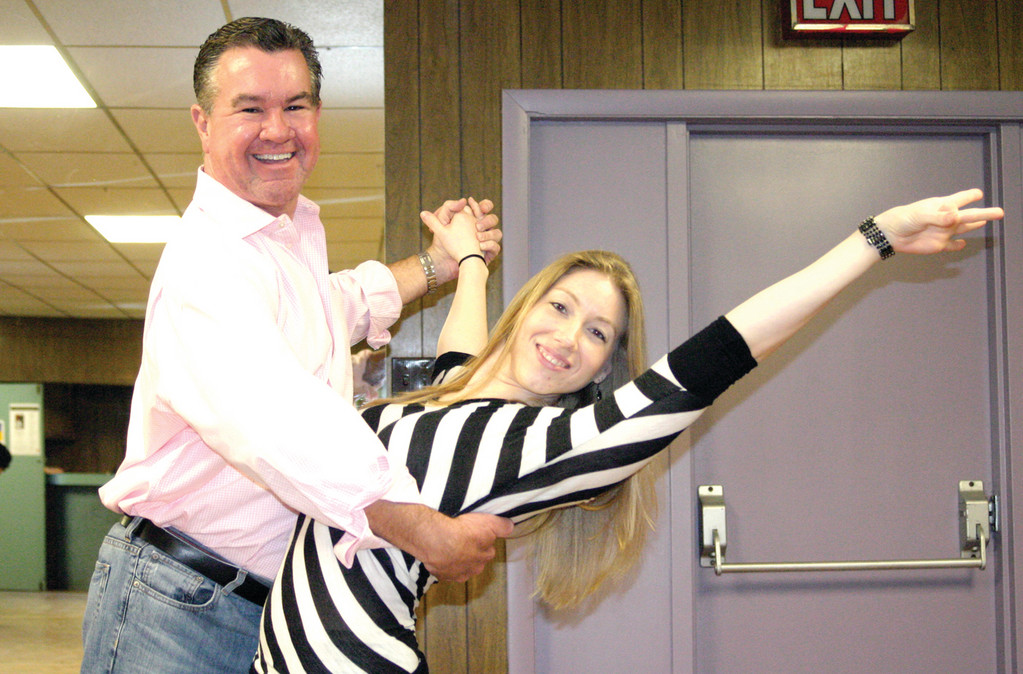 FEELIN' IT: As they rehearse for the sixth annual Dancing with the Stars of Mentoring competition, which will take place April 26 at Rhodes on the Pawtuxet in Cranston from 5:30 to 9 p.m., attorney John Carroll and dance instructor Rachael Capodanno strike a pose. Funds raised will benefit the Rhode Island Mentoring Partnership, a non-profit organization that mentors more than 5,500 children statewide.