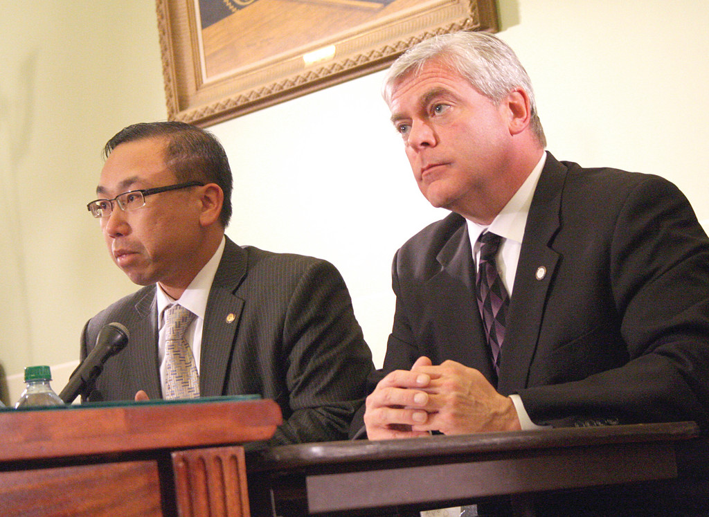 NOTHING TO SMILE ABOUT: Cranston Mayor Allan Fung and Warwick Mayor Scott Avedisian prepare to testify last Thursday before the Senate Finance Committee on the legislative package the governor is offering to help municipalities.