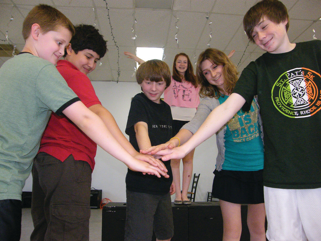 "IN IT TOGETHER: Students involved in the Young PlayRIYTs camp could choose to write, act or both. Here the cast of ""Sherwood Forest"" rehearses a scene. From left are Cooper Cardone, 11; Logan Branch, 12; playwright Mitchell Cardone, 13; Brooke Fennell, 13; and Jack Fitzgerald, 13. In the background is Rebecca Malachowski, age 14."