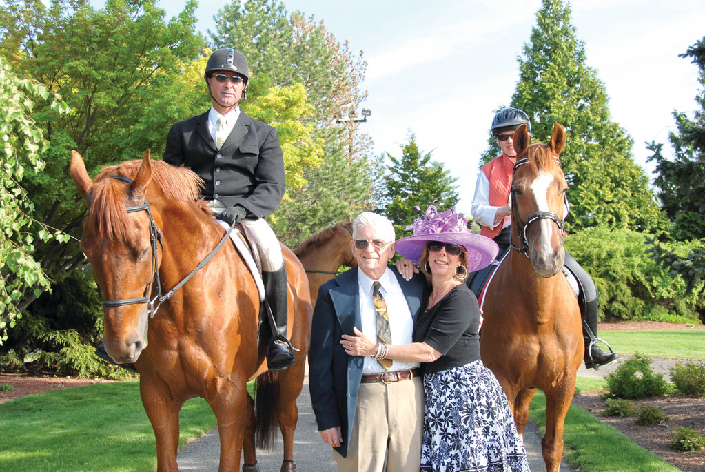 HOLD YOUR HORSES: The Elizabeth Buffum Chace Center Run for the Roses fundraising dinner event will take place May 5 at the Aldrich Mansion at 836 Warwick Neck. Last year, Edward Medieiros and his daughter, Katherine Descault (center), enjoyed the event.