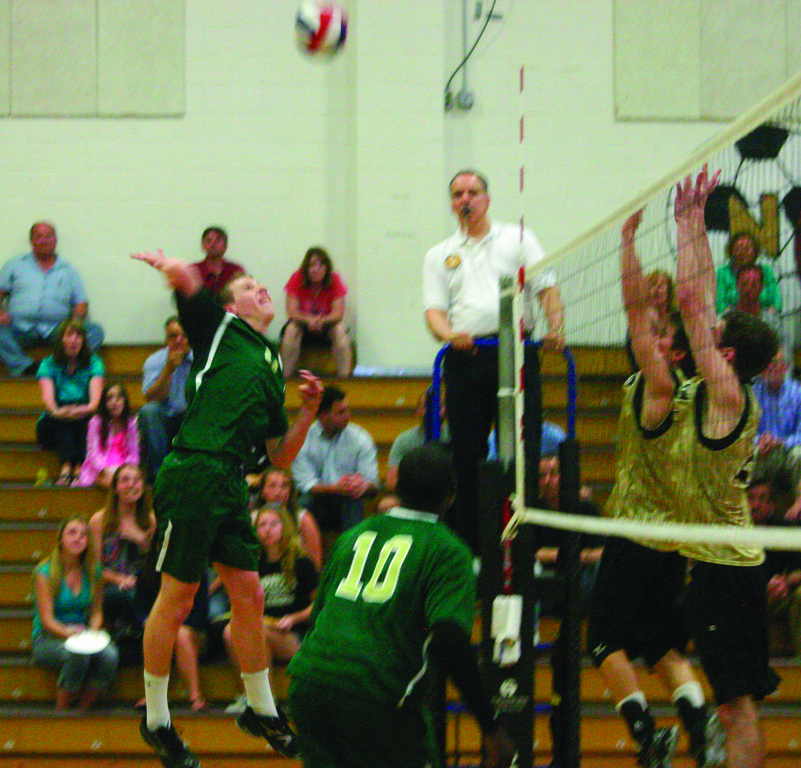 RISING UP: John Kane leaps for a kill.