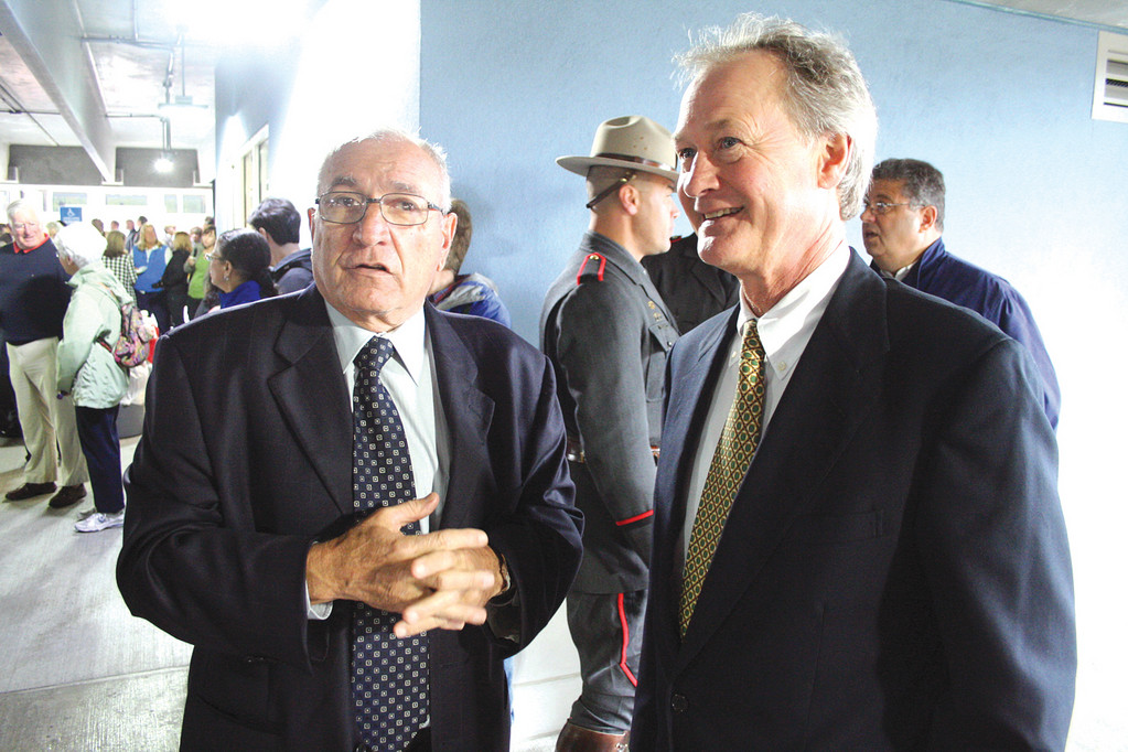 Robert Cioe, who pursued his dream to build the station, talks with Governor Chafee.