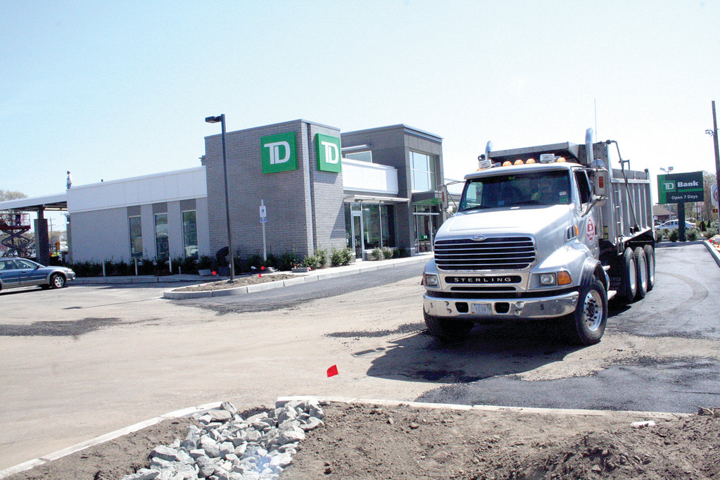 READY TO COME ON LINE: Crews finish the parking lot at the TD Bank at Wildes Corner. The bank�s grand opening will be held May 5.