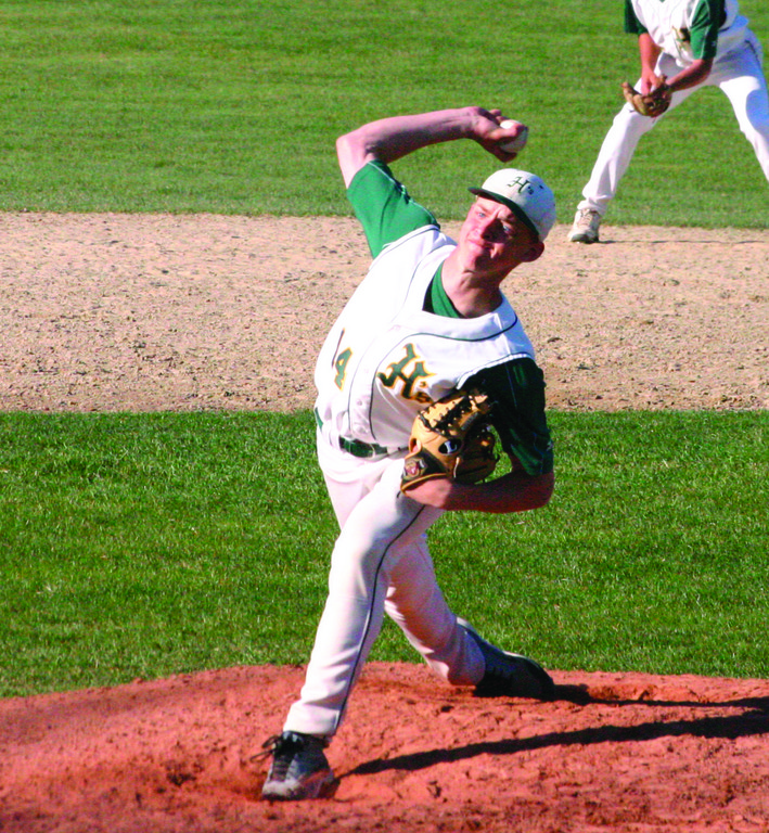 DELIVERING: Hendricken's Mike King makes a pitch in Friday's game against Cranston East. The Hawks beat the 'Bolts 9-1 to improve to 7-0 on the season. The have scored more runs and allowed fewer than any team in the state.