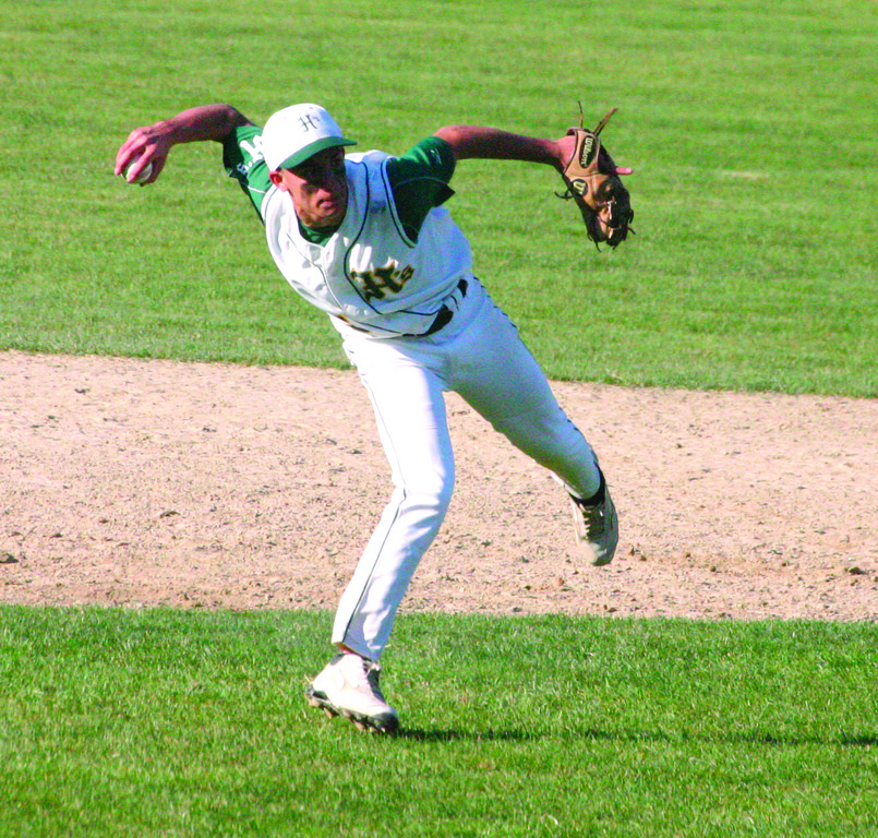 FLYING THROW: Lou Umberto lines up a throw after making a tough play at shortstop during Friday's game.