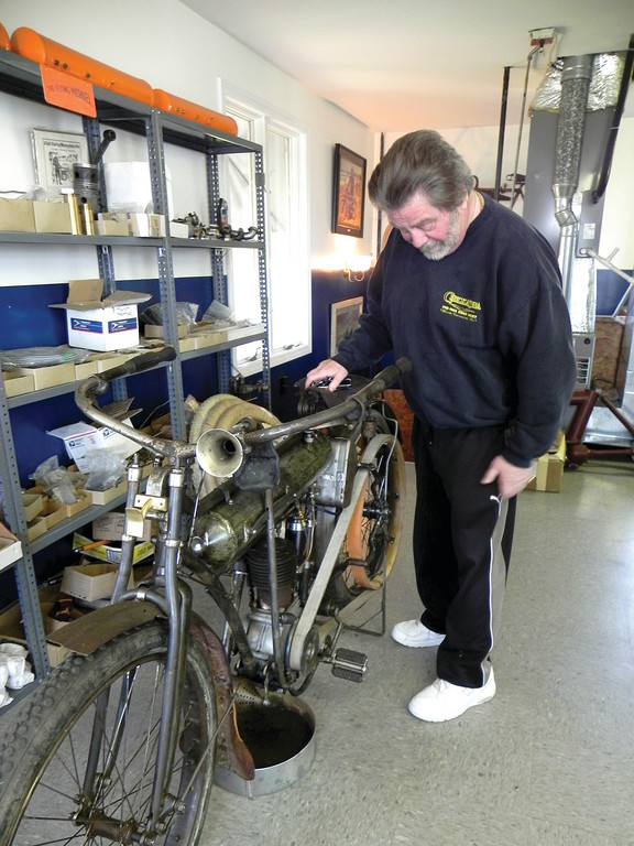 IT LEAKS: One of the disadvantages of running an original unrestored vintage motorcycle is that they leak for some time after you park them, which is why Shappy has a pan placed under the engine of this 1910 Yale Single.