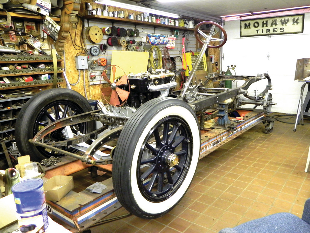 EARLY INDY CAR: One of Shappy's current restorations is a 1912 National Speedway Roadster, like the ones that raced when the legendary Brick Yard in Indianapolis was young. Shappy and his mechanics depend on factory repair manuals (right) to do the job properly.