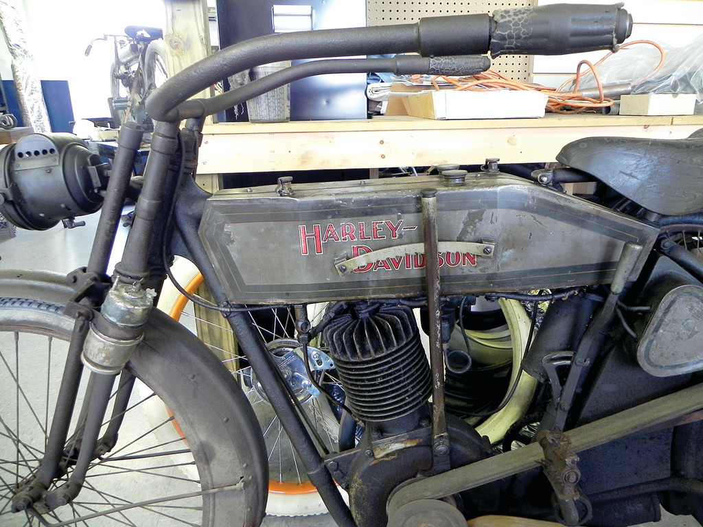 "ORIGINAL UNRESTORED: A 1912 Harley-Davidson that was purchased at an auction will most likely be sold ""as is"" by vintage motorcycle dealer Dick Shappy. There is a growing market for cars and motorcycles that still have all the parts they left the factory with, whether they work or not."