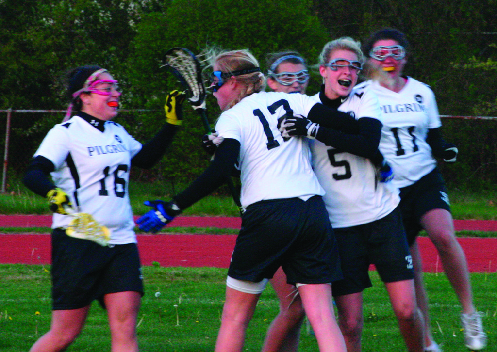 MAKE IT TWO: Pilgrim players mob Betsy Heidel after she scored the game-winning goal Tuesday.