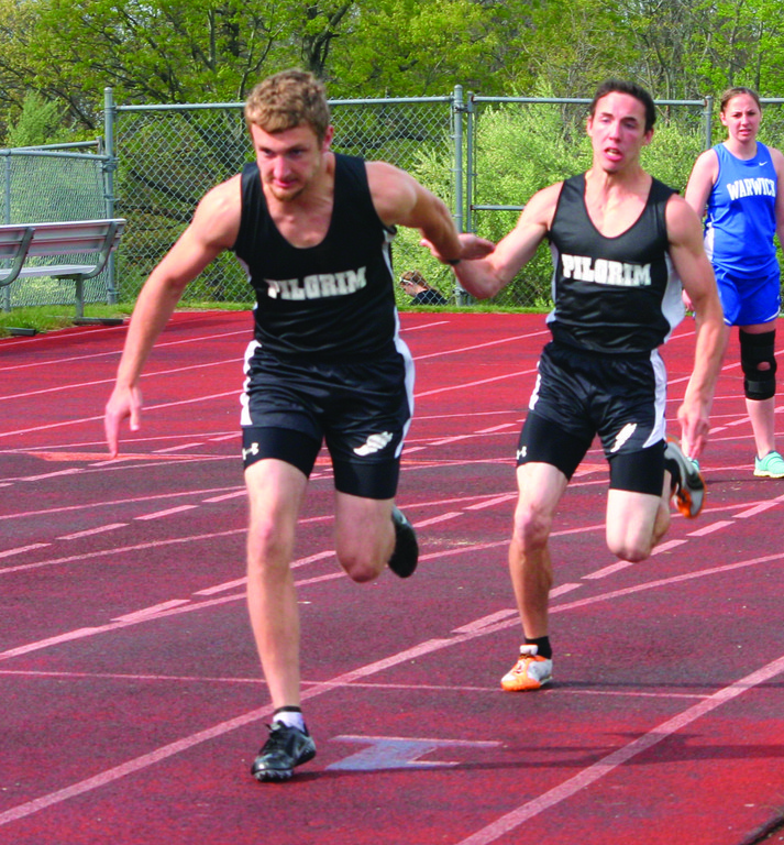 SETTING THE PACE: Carl Sjogren takes the baton from Derek Daluz in the 4x100 relay on Tuesday.