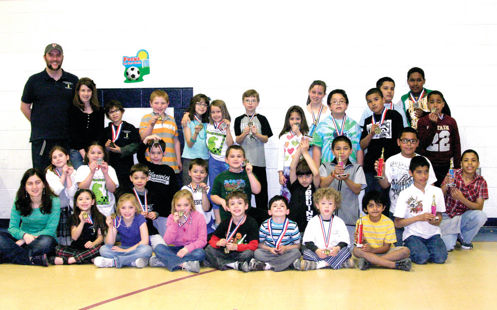 CHECKMATE: More than 35 children from Greenwood Elementary School and beyond gathered at the school Saturday to take part in a chess tournament that prepared them for the upcoming national competition in Tennessee. With coaches Stephen Moore and Ana Izoria at left, Greenwood students in the center and children from Central Falls at left, each child went home with either a trophy or a medal.