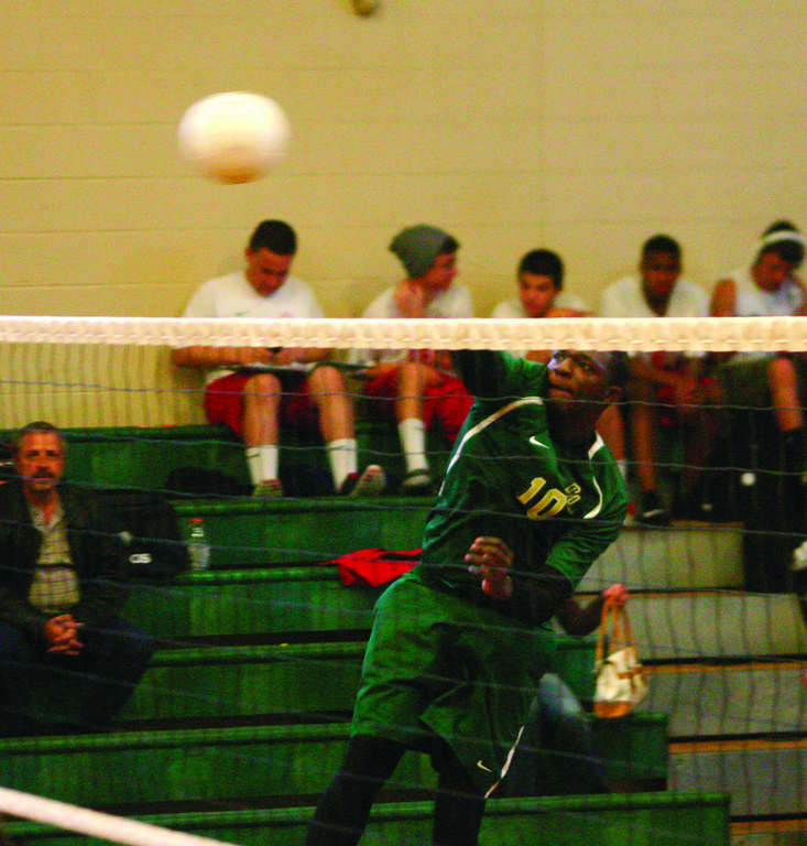 SWINGING: Hendricken's Jahari Ford follows through on a kill during Friday's match against East Providence.