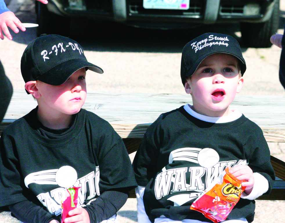 Two young players enjoy a snack.