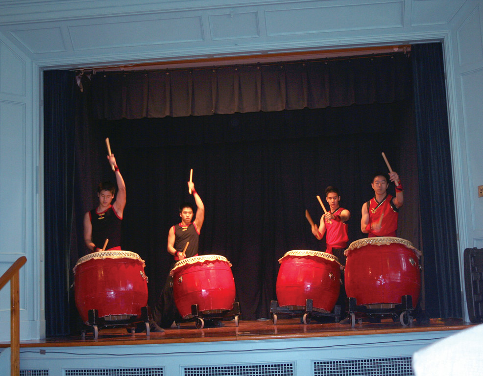 NOT YOUR TYPICAL DRUMMERS: Performers from the Chinese Folk Art Workshop, Inc. out of Woburn, Mass., start the Opening Ceremonies at Hall Library with a dramatic performance.