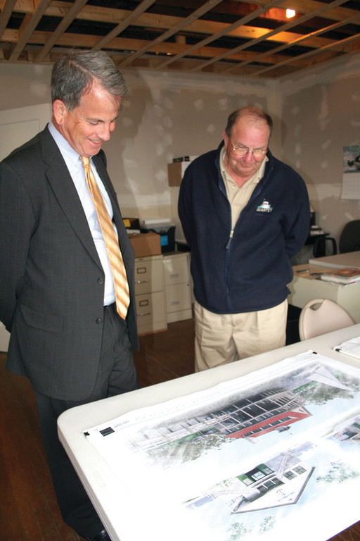 SAILING FORWARD: Commodore Jeff Lanphear and former commodore Bill Plumb, who is serving as co-chair of the fundraising committee, look over proposed renderings of a new Edgewood Yacht Club clubhouse.