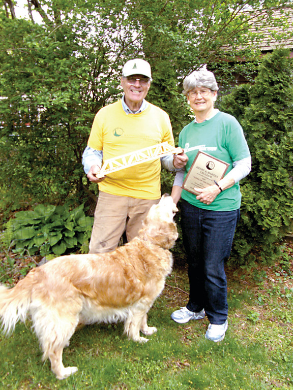 AWARD RECIPIENTS: Martha and Henry Cruciani, pictured here outside their Warwick home with their dog, Murphy, are part of the Narragansett Chapter of the Appalachian Mountain Club.
