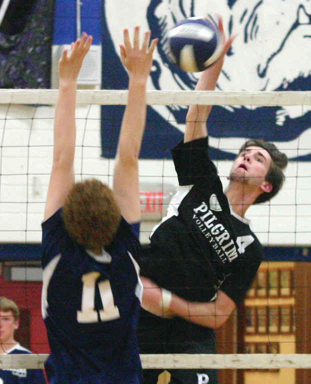 HIT IT: Pilgrim's John Zuffoletti rises for a kill in Tuesday's match against Westerly. The Pats won 3-0 to finish the first half of the season with a perfect 8-0 record.