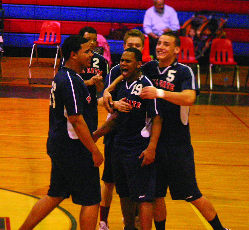 GOOD TIMES: Teammates celebrate with Wellington Araujo after the kill to cap a dramatic comeback in game two of Tuesday's match. The Titans won for the second time in three months.