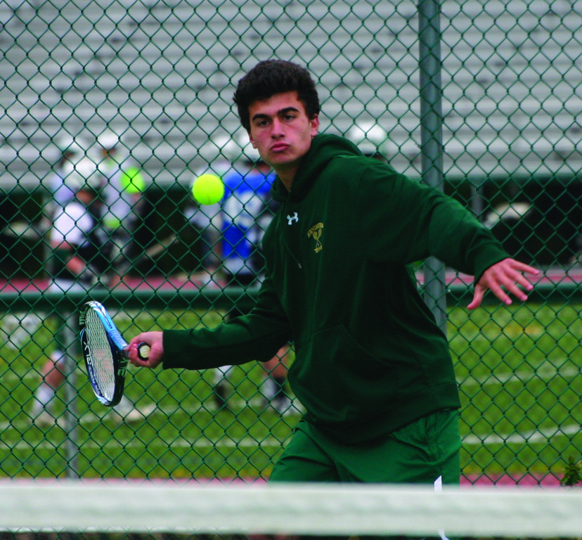 EYE ON IT: Hendricken's Zach Prinscott hits a return in last week's match against Mount St. Charles.