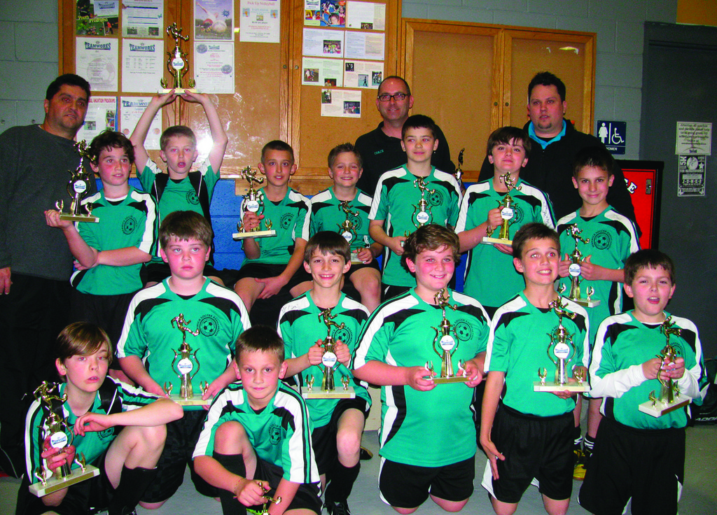 AT THE TOP AGAIN: Pictured, front row: William Blythe, Andrew Fredericks, Danny Peixinho, Matthew Zubrycki, Jesse Kase, Kyle Hadfield, Brandon Venda. Back row: Levi Kase, Danny Lajoie, David D'Andrea, Joey Silvestre, Aaron Antczak, Will Pariseau and Steven Peixinho. Coaches: Joseph Silvestre, Scott Lajoie and Danny Peixinho.