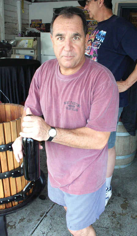 WINEMAKER: Robert Mastronardi as seen in October of 2007 during his winemaking operations in Knightsville, Cranston.