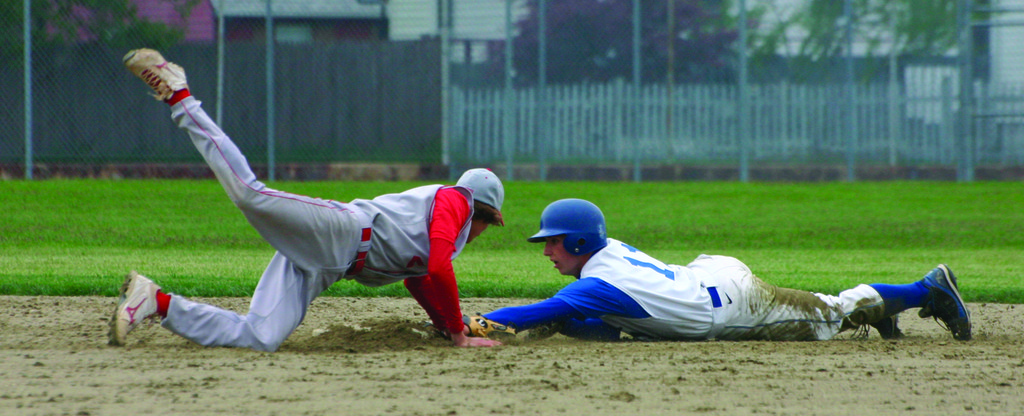 IN THERE: Kevin Hickey barely holds onto second base after stealing while East Providence's Scott Mello tries to tag him out during Tuesday's game. Hickey was safe on the play.