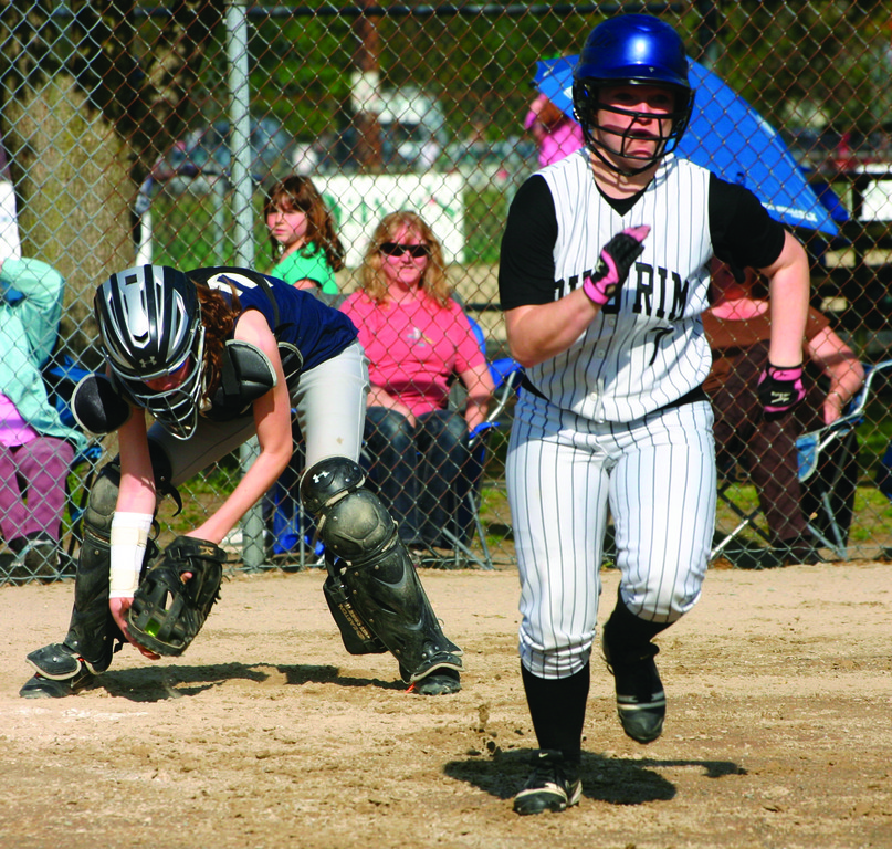 GOING HARD: Pilgrim's Tiffany Legare sprints to first base on a bunt in Monday's game against Moses Brown.
