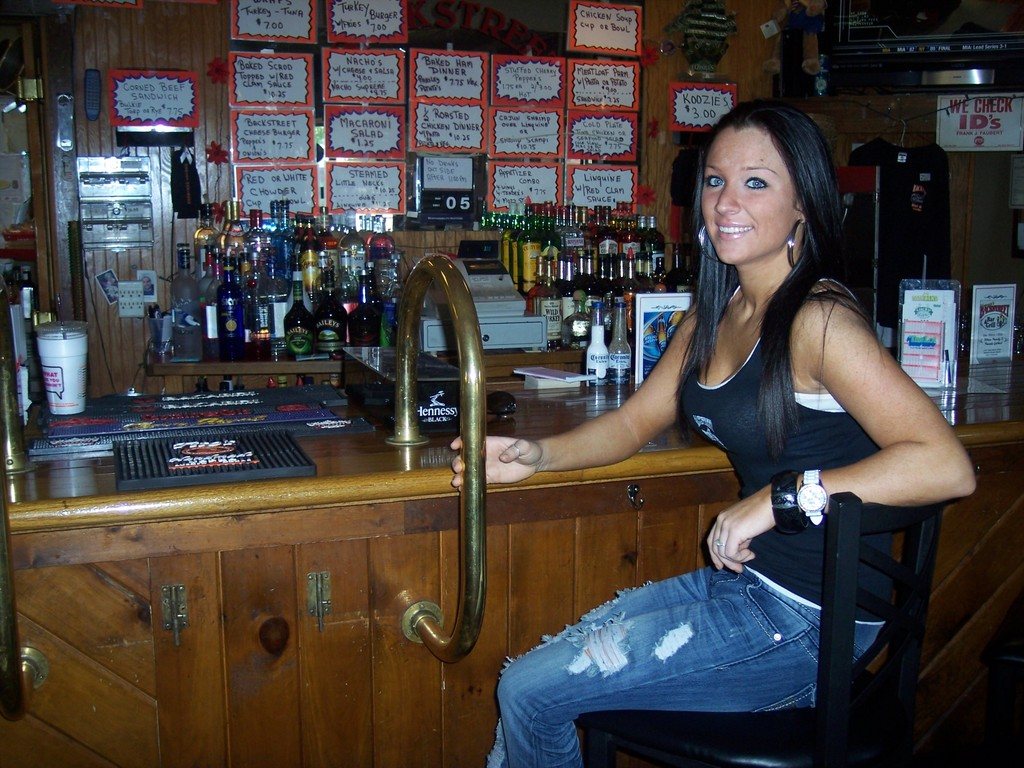 For the best view in the house, bartender Michele takes a barstool in front of the bar for a change of scenery.