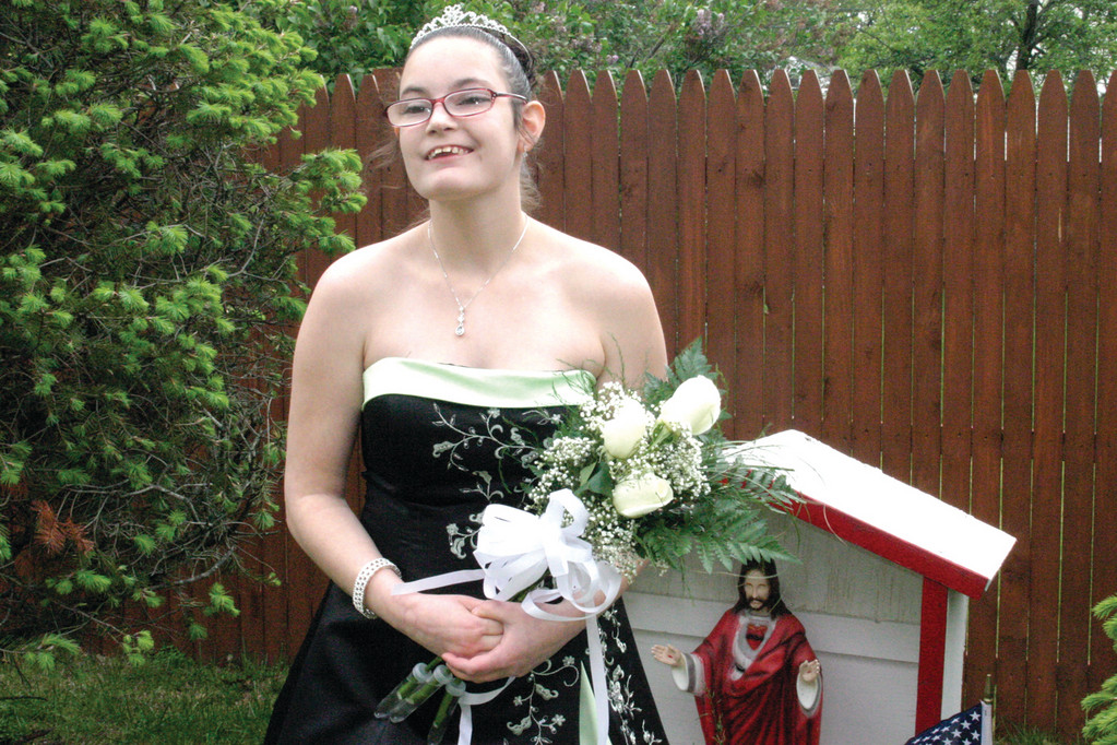GORGEOUS GOWN: After Trudeau Center staff members donated gowns, slacks, suit jackets and shirts, clients sifted through the cloths and selected garments they plan to wear Friday evening at their very first prom. Caitlyn Blain, 18, an eleventh grader at Toll Gate, models her gown outside her Warwick home.