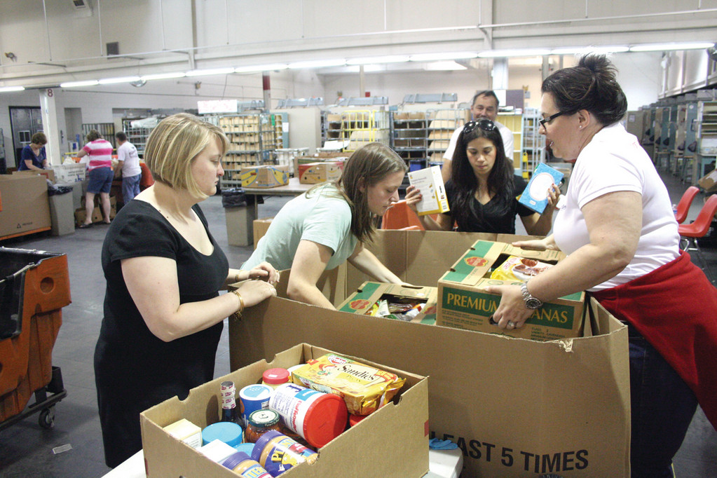 Members of the Rhode Island Junior League sort through food donations while working from Warwick�s central Post Office on Strawberry Field Road.