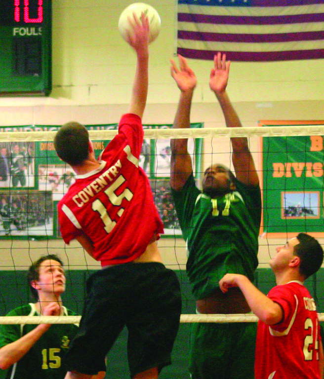 BLOCK IT: Hendricken's Rilwan Ilumoka goes up for a block in Thursday's match against Coventry.