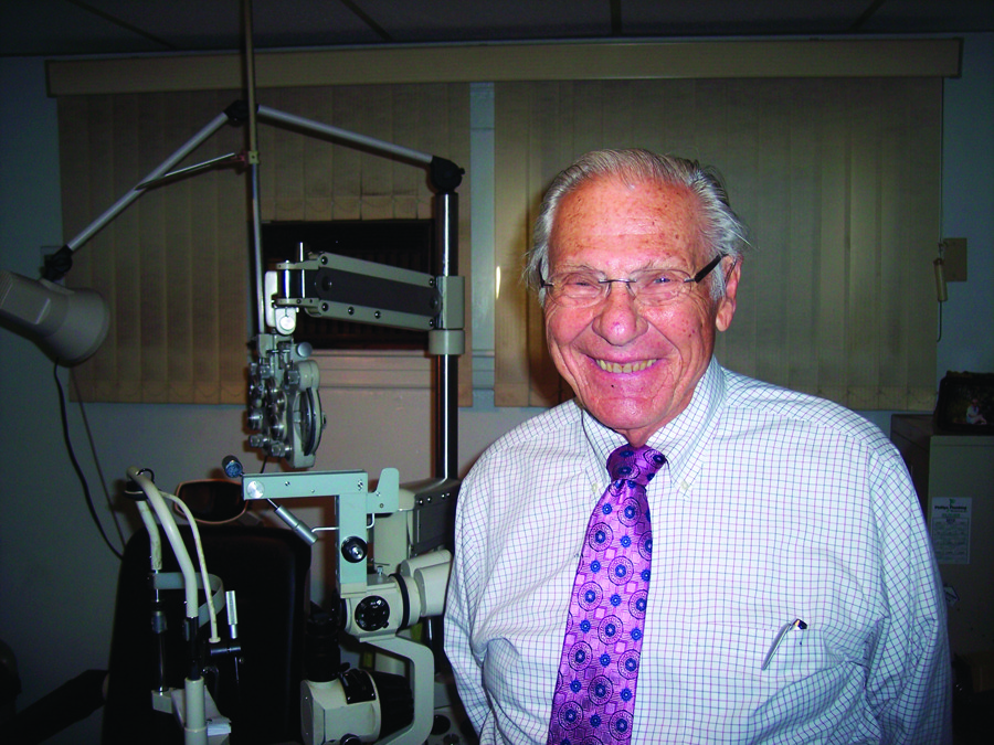 Dr. Albert Glucksman, family optometrist and longtime champion of good vision for Special Olympians, poses here in his office.