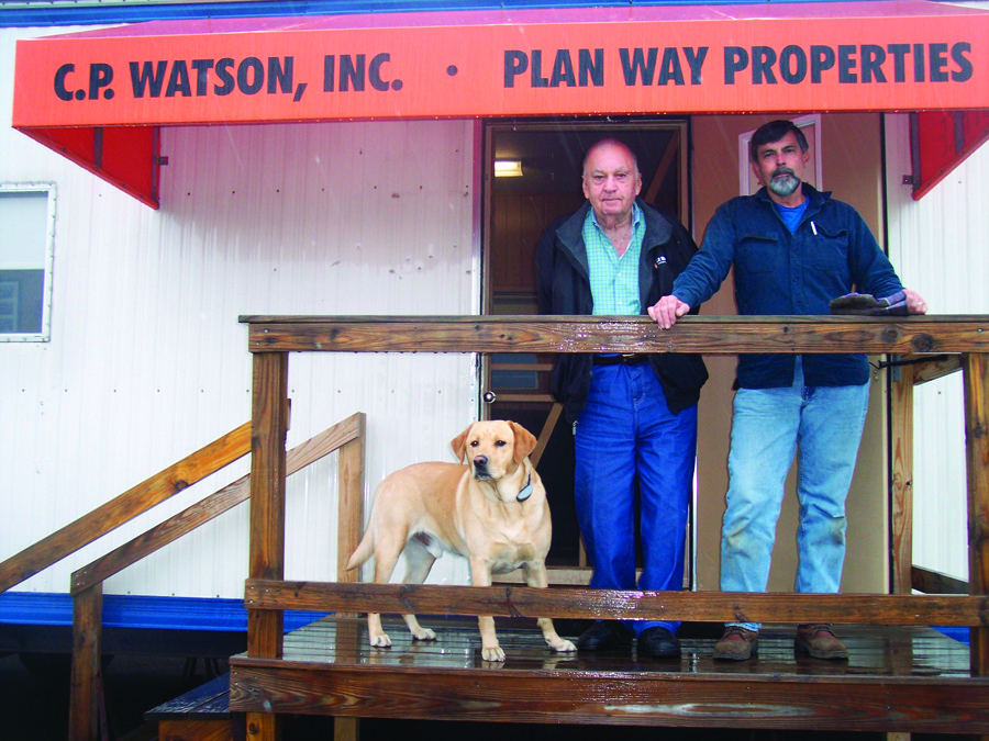 "Meet Donald and Howard Watson with their devoted ""Chance,"" ready to supply you with all your landscape surfacing materials."