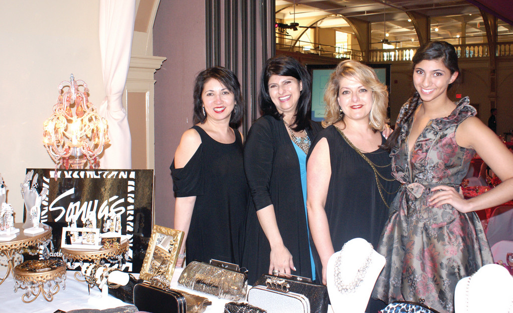 A SPLASH OF SONYA�S: Sonya�s of Cranston not only supplied the gorgeous gowns for the Fashion Show but also set up a booth at the vendor marketplace that was visited by hundreds of people during the show to benefit the Gloria Gemma Breast Cancer Resource Foundation. Pictured from Sonya�s are Alice Paloulian, owner Sonya Janigian, Rena Megrdichian and Sevan Janigian.