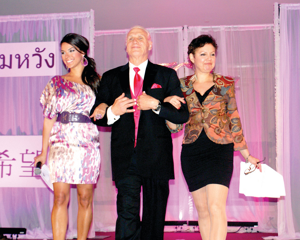 "EMCEES PLUS ONE: Pictured with Gary Calvino, director of development for the Gloria Gemma Breast Cancer Resource Foundation, are the co-masters of ceremonies Amy Diaz, co-host of Social Woman and Barbara Morse Silva, ""Sunrise"" co-anchor and Health Reporter for TV 10."