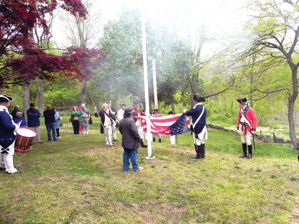 SMOKE AND NOISE: Visiting militias greeted the raising of the flag at the Greene Homestead in Coventry with musket fire. The Homestead's Association would like to see more appreciation for General Nathanael on a local and national level.