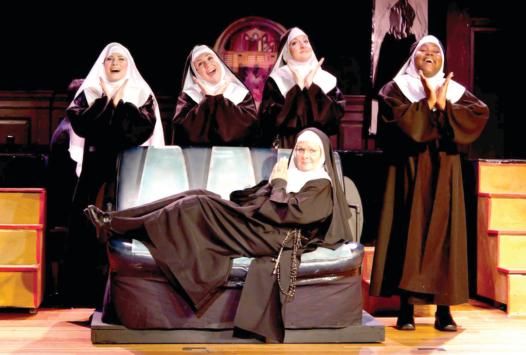 "BACK IN BLACK: Marilyn Farina, seated at center, will play Mother Superior in Courthouse Center for the Art's ""Nunsense,"" now through June 3. She's joined by, from left, Dana Domenick, Kaitlyn Rosen, Katie Claire Bradley and Ashley Kelley."