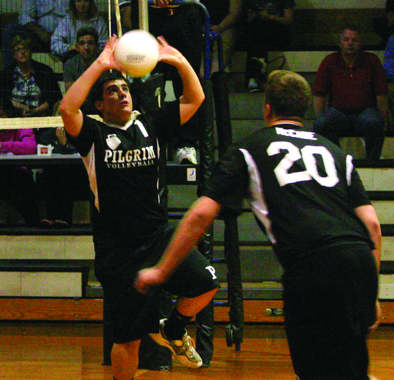 GOING UP: Pilgrim's Jason Ferguson sets the ball for teammate Matt McCabe in Tuesday's match.